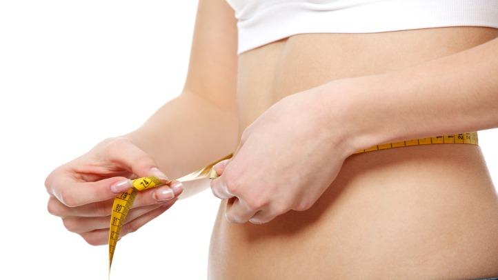 02242011 generic girl-measuring-waist