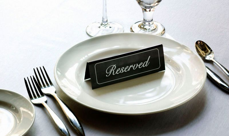 Reserved placard on place setting at fine dining restaurant.