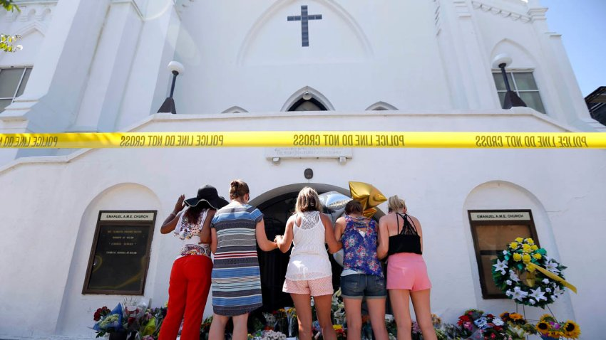 In this June 18, 2015, file photo, a group of women pray together at a make-shift memorial on the sidewalk in front of the Emanuel AME Church in Charleston, South Carolina. Wednesday marks the fifth anniversary of the shooting.
