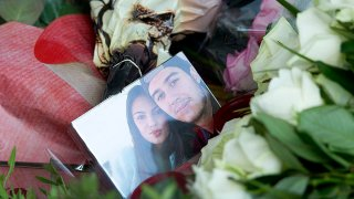 In this file photo, a picture of Bryce Fredriksz, right, and his girlfriend Daisy Oehlers, left, who died on flight MH17, is surrounded by flowers at Schiphol airport in Amsterdam, Sunday, July 20, 2014.