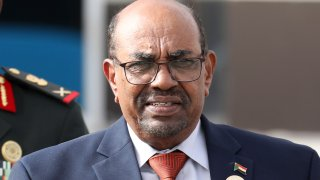 In this July 2, 2018 file photo, Sudanese President Omar al-Bashir leaves the African Union summit, in Nouakchott, Mauritania