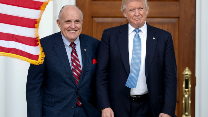 In this Nov. 20, 2016, file photo, then-President-elect Donald Trump, right, and former New York Mayor Rudy Giuliani pose for photographs as Giuliani arrives at the Trump National Golf Club Bedminster clubhouse in Bedminster, N.J..