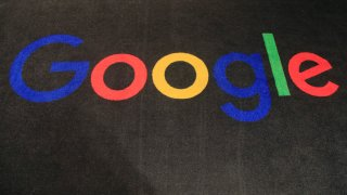 In this Monday, Nov. 18, 2019 file photo, the logo of Google is displayed on a carpet at the entrance hall of Google France in Paris.