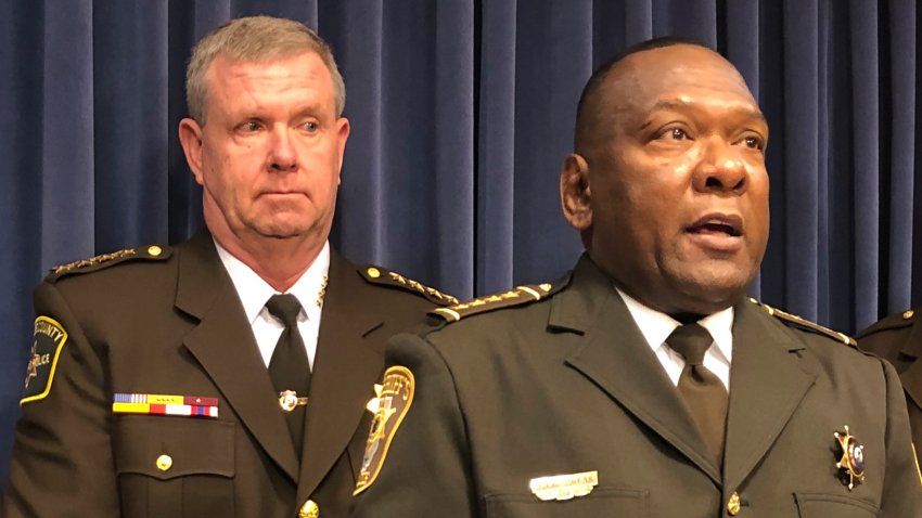 Kankakee County Sheriff Mike Downey, left, joins Livingston County Sheriff Tony Childress, right, at the state Capitol Tuesday, Feb. 25, 2020, in Springfield, Illinois. Both men protested the end of a practice by the Illinois Department of Corrections to transfer released inmates who have warrants or immigration detainers to Pontiac Correctional Center, where the Kankakee Sheriff's Department picked them up and detained them for U.S. Immigration and Customs Enforcement for deportation hearings.