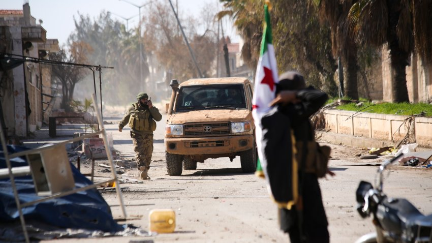 Turkish backed Syrian rebels enter the own of Saraqeb, in Idlib province, Syria, Thursday, Feb. 27, 2020.