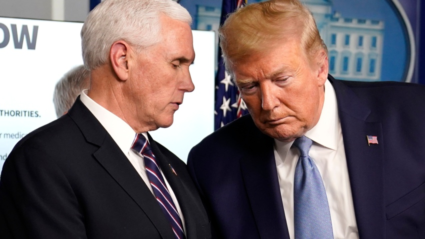President Donald Trump listens to Vice President Mike Pence