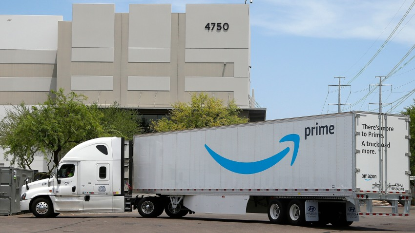 This July 17, 2019, file photo shows an Amazon shipping truck at a fulfillment center in Phoenix.