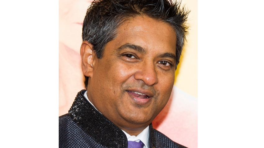 """FILE - This Aug. 4, 2014 file photo shows chef Floyd Cardoz at """"The Hundred-Foot Journey"""" premiere in New York. Cardoz, who competed on """"Top Chef,"""" won """"Top Chef Masters"""" and operated successful restaurants in both India and New York, has died of complications from the coronavirus, his company said Wednesday. He was 59."""