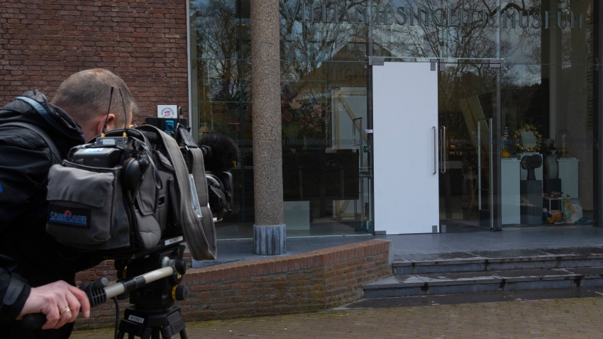 A cameraman films the glass door which was smashed during a break-in at the Singer Museum in Laren, Netherlands