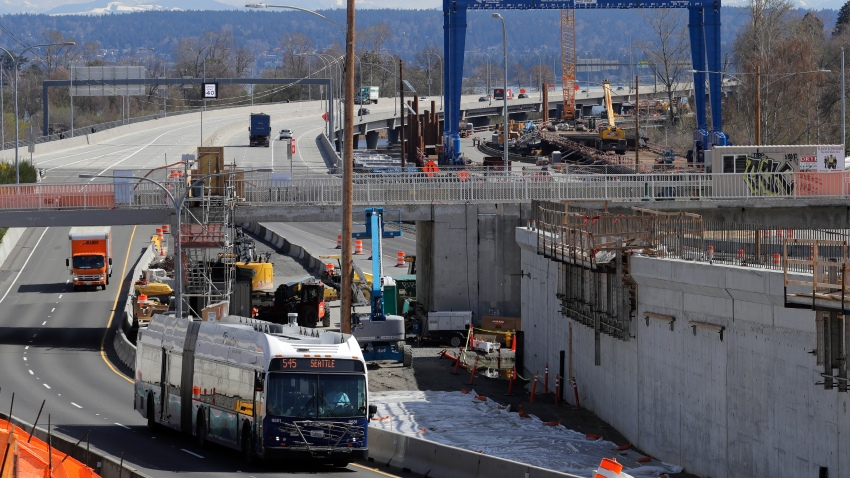 a bus drives past a roadwork construction project in Seattle