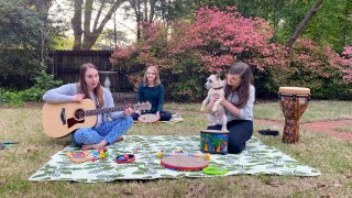 In this April 10, 2020 image from video, music therapists for St. Jude Children's Research Hospital, from left, Celeste Douglas, intern Abigail Parrish and Amy Love record a session in Love's backyard in Memphis, Tennessee.