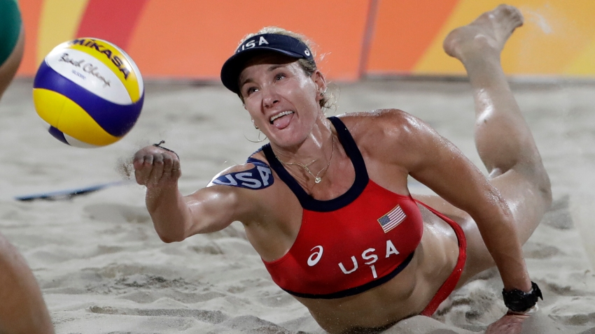 Kerri Walsh Jennings digs for a ball