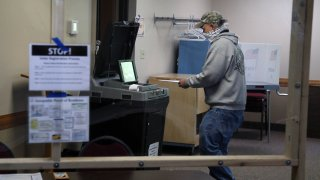 Voter places ballot in the counter machine