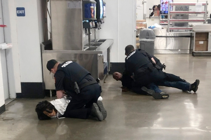 In this March 23, 2020 frame grab taken from video, Marvia Gray, left and her son Derek Gray are arrested at a Sam's Club store in Des Peres, Missouri. A lawsuit filed Monday May 18, 2020, accuses four white suburban St. Louis police officers of brutalizing Gray and her adult son after wrongly accusing them of stealing a television. Gray alleges she suffered serious and permanent injuries during her arrest. Her 43-year-old son, Derek, suffered a concussion, three shattered teeth and other injuries, according to the lawsuit.