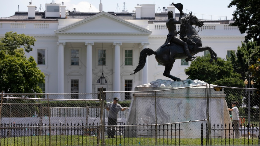 The base of the statue of former president Andrew Jackson is power washed inside a newly closed Lafayette Park, Wednesday, June 24, 2020, in Washington.