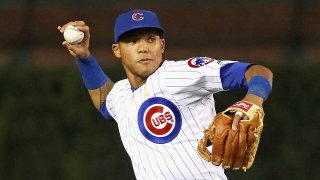 Addison Russell throws from shortstop in a game at Chicago's Wrigley Field.