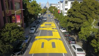 """An aerial photo shows a giant street mural reading """"Black Lives Matter"""" in San Francisco."""