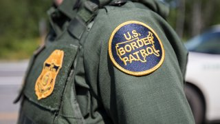 In this Aug. 1, 2018, file photo, a patch on the uniform of a U.S. Border Patrol agent at a highway checkpoint in West Enfield, Maine.