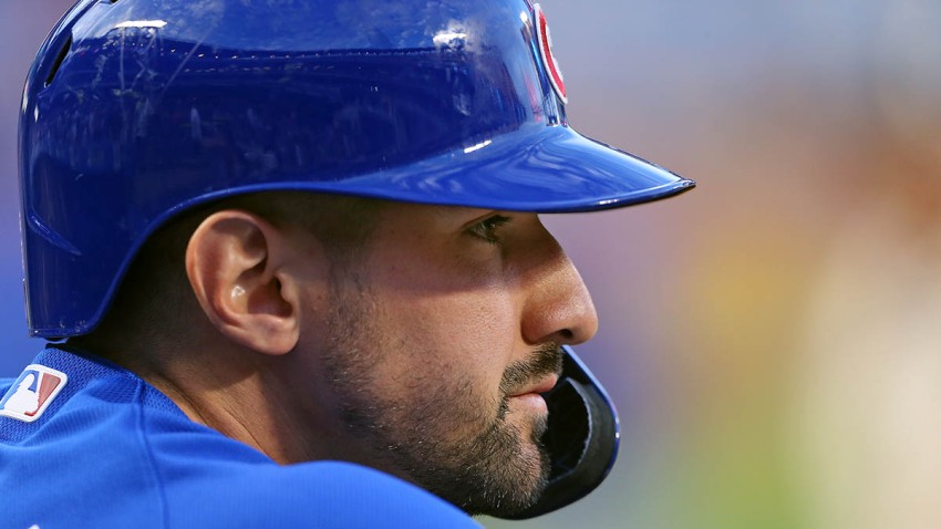 Nicholas Castellanos looks on from the dugout during a Cubs game against the New York Mets