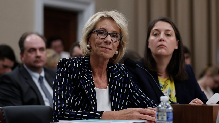 In this May 24, 2017, file photo, Education Secretary Betsy DeVos, left, joined by Education Department Budget Service Director Erica Navarro, testifies before the House Appropriations Labor, Health and Human Services, Education, and Related Agencies subcommittee hearing on the Education Department's fiscal 2018 budget on Capitol Hill in Washington, DC.