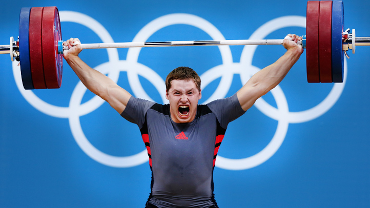 weightlifter with olympic rings