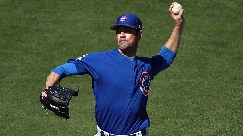 Cole Hamels delivers a pitch during a spring training game between the Boston Red Sox and Chicago Cubs.
