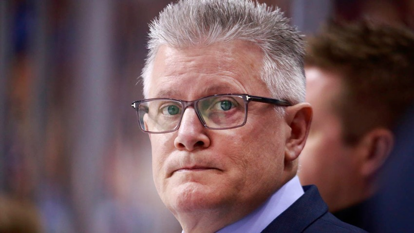 Chicago Blackhawks assistant coach Marc Crawford stands on the bench during a March 20th game in Vancouver.