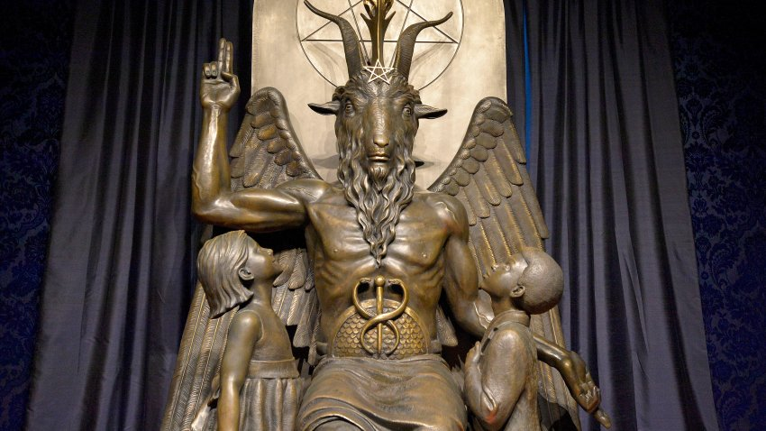 """The Baphomet statue is seen in the conversion room at the Satanic Temple where a """"Hell House"""" is being held in Salem, Massachusett on October 8, 2019."""