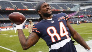 Cordarrelle Patterson throws a football to a fan during a Bears game at Soldier Field