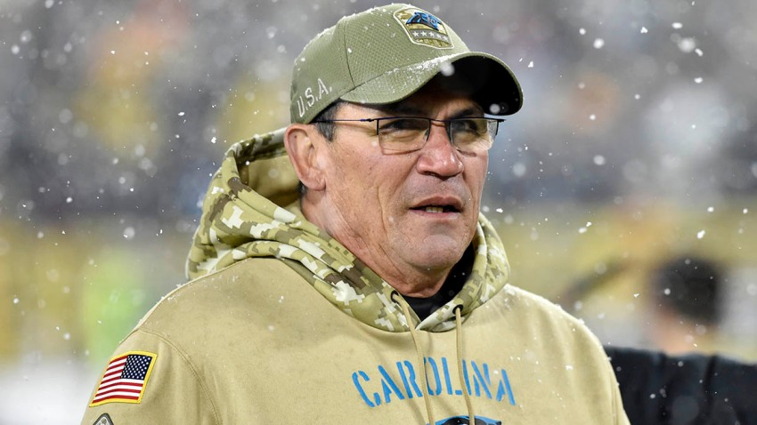 Carolina Panthers head coach Ron Rivera walks off the field after a game against the Green Bay Packers.