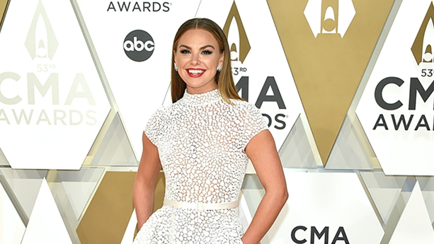In this Nov. 13, 2019, file photo, Hannah Brown attends the 53rd annual CMA Awards at the Music City Center in Nashville, Tennessee.
