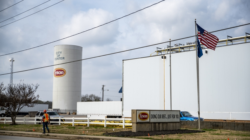 A worker walks past the Tyson Foods Inc. processing plant in Center, Texas
