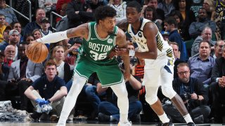 Marcus Smart of the Boston Celtics handles the ball against the Indiana Pacers on March 10, 2020, at Bankers Life Fieldhouse in Indianapolis.