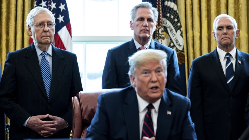 Senate Majority Leader Mitch McConnell, a Republican from Kentucky, from left, U.S. House Minority Leader Kevin McCarthy, a Republican from California, and U.S. Vice President Mike Pence listen as U.S. President Donald Trump speaks before signing the H.R. 748, Coronavirus Aid, Relief, and Economic Security (CARES) Act, in the Oval Office of the White House in Washington, D.C., U.S., on Friday, March 27, 2020. Trump signed the largest stimulus package in U.S. history today, a $2 trillion bill intended to rescue the coronavirus-battered economy after the House approved it earlier.