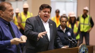 Illinois Gov. J.B. Pritzker speaks during a news conference in Hall C Unit 1 of the COVID-19 alternate site at McCormick Place in Chicago on Friday, April 3, 2020. Hall C will house 500 beds.