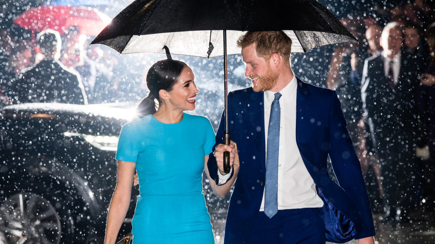 Prince Harry and Meghan under an umbrella
