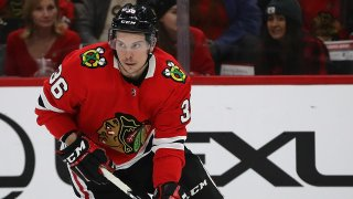 Blackhawks forward Matthew Highmore skates with the puck during a February game