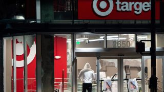 Looters rob a Target store as protesters face off against police in Oakland California