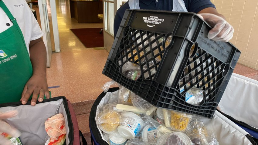 Free meals offered by the Board of Education of the City of New York are prepared for distribution at a school during the Coronavirus pandemic