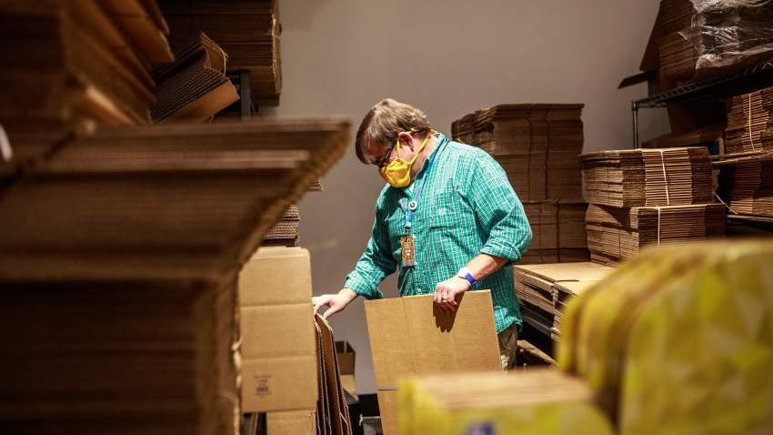 Legacy Toys Store Manager Jeff Kasper sorts through shipping boxes at the store in the Mall of America on June 16, 2020 in Bloomington, Minnesota.