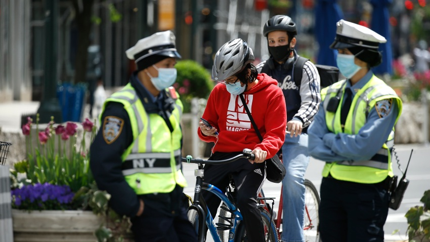 Bicyclists and NYPD traffic officers are seen during the coronavirus pandemic on May 14 2020 in New York City.