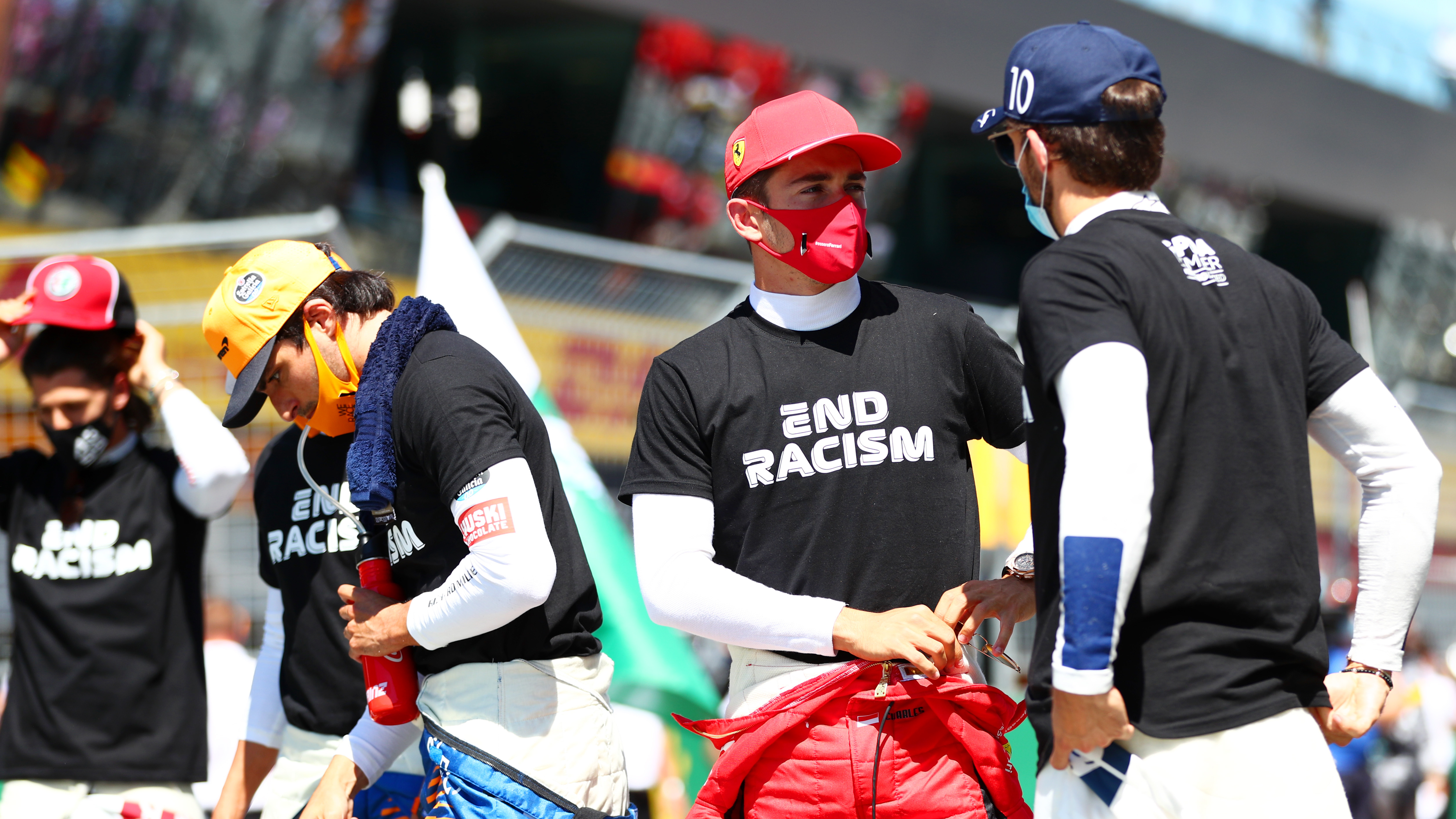 Formula One Drivers Wear 'End Racism' Shirts and Take a Knee Before Season Opener