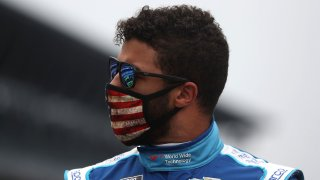 Bubba Wallace walks the grid prior to the NASCAR Cup Series Big Machine Hand Sanitizer 400 Powered by Big Machine Records at Indianapolis Motor Speedway on July 5, 2020, in Indianapolis.