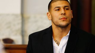 Aaron Hernandez sits in the courtroom of the Attleboro District Court during his hearing on August 22, 2013 in North Attleboro, Massachusetts.