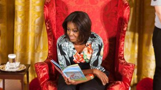 """Michelle Obama reads Dr. Seusss """"Oh, The Things You Can Do That Are Good for You!"""" to local students as part of her """"Let's Move, Let's Read!"""" initiative"""