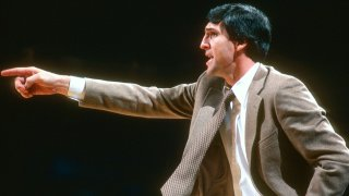 Head coach Jerry Sloan of the Chicago Bulls looks on from the sidelines against the Washington Bullets during an NBA basketball game circa 1981