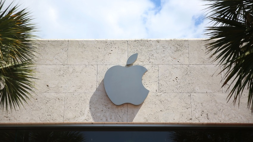 An Apple sign is seen outside of a store on April 26, 2016 in Miami Beach, Florida.