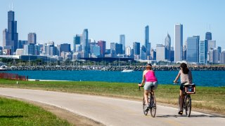 Cyclists ride along Lake Michigan in Chicago