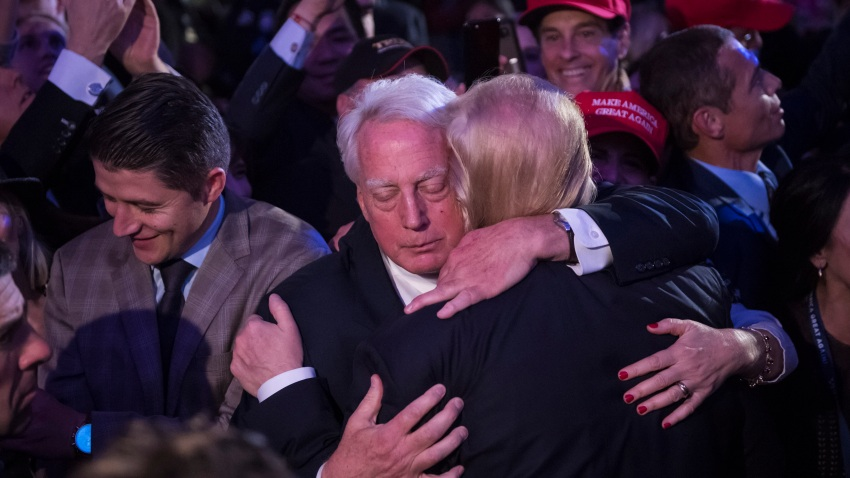 President-elect Donald Trump hugs his brother Robert Trump in the crowd after speaking during an election rally in midtown in New York, NY on Wednesday November 09, 2016.