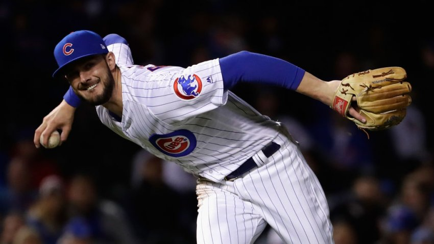 Kris Bryant fields a ball during the National League Championship Series at Wrigley Field